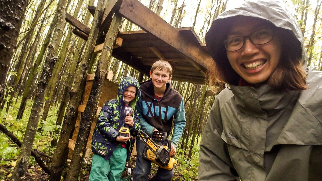 buliding tree house in a forest with kids during helpX in a farm in alberta canada