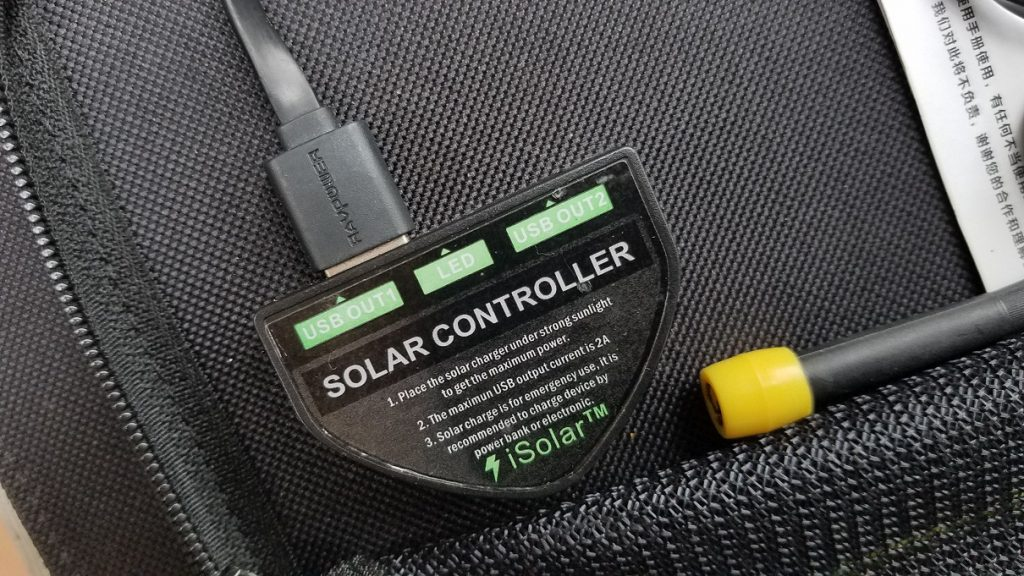 xdragon solar cellphone charger showing the USB connectors convenient light for digital nomad backpackers