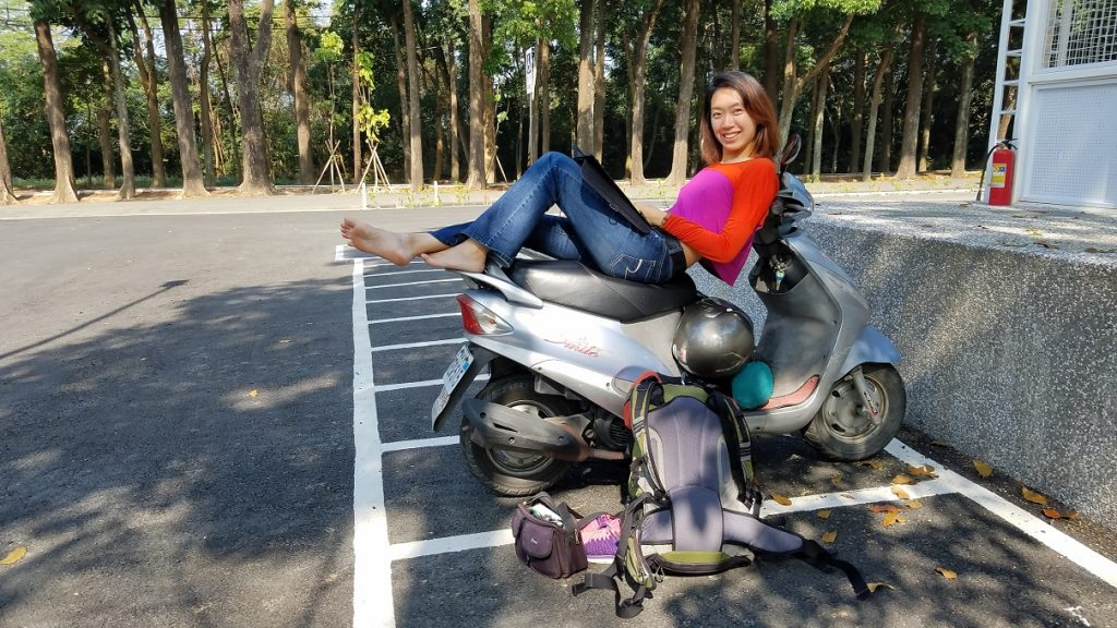me working using solar panel cellphone charger on a scooter in taiwan smaller