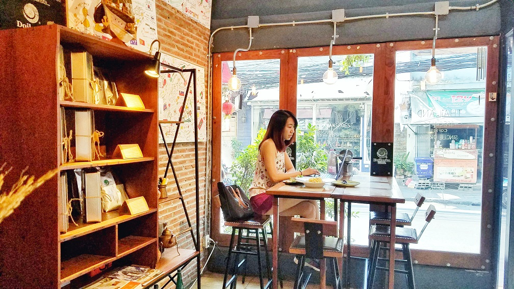 working remotely in a cafe in Bangkok